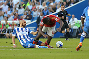 Bruno Saltor of Brighton & Hove Albion tackles midfielder Michail Antonio of Nottingham Forest during the Sky Bet Championship match between Brighton and Hove Albion and Nottingham Forest at The American Express Community Stadium, Brighton and Hove, England on 7 August 2015. Photo by Phil Duncan.