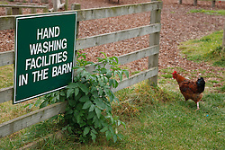 Sign at farm open to the public advising people to wash their hands