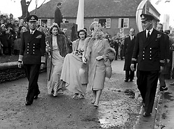 King George VI and Queen Elizabeth arrive at Romsey Abbey in the New Forest with bridesmaids Princesses Elizabeth and Margaret, for the wedding of Patricia Mountbatten (the daughter of Viscount Mountbatten) and Lord Brabourne. Philip Mountbatten (of Greece) can be seen, right. Princess Alexandra of Kent was also a bridesmaid.