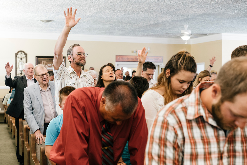 Church members pray during service at Full Gospel Pentecostal Church in Martinsburg, WV on June 4, 2017.