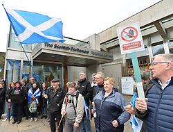 Campaign group Hands Off Our Parliament staged a rally outside the Scottish Parliament in Edinburgh today where protesters formed a symbolic protective ring around the parliament in response to what the campaigners claim is a power grab by the UK government.<br /> <br /> © Dave Johnston/ EEm
