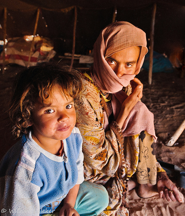 Deep in the Moroccan desert near the Algerian border I came upon three generations of a Berber family living in isolation: a grandmother, mother and child who kindly invited me into their tent for tea.