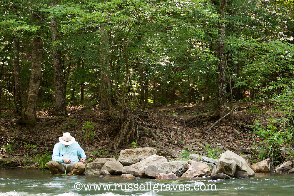 FLY ANGLER WADING IN THE MOUNTAIN FORK RIVER IN BROKEN BOW, OKLAHOMA
