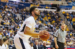 Nov 20, 2016; Morgantown, WV, USA; West Virginia Mountaineers forward Esa Ahmad (23) shoots a three pointer from the corner during the second half against the New Hampshire Wildcats at WVU Coliseum. Mandatory Credit: Ben Queen-USA TODAY Sports