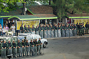 29 MAY 2014 - BANGKOK, THAILAND:  Thai soldiers line the road around Victory Monument. After a series of protests around Victory Monument earlier in the week, the Thai army Thursday shut down vehicle access to the area, one of the main intersections in Bangkok, and kept people out of the area. Thousands of soldiers surrounded the Monument and effectively locked the area down. There were no protests at Victory Monument for the first time in the week since the coup deposed the elected civilian government.  PHOTO BY JACK KURTZ