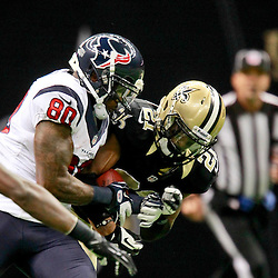 August 25, 2012; New Orleans, LA, USA; New Orleans Saints cornerback Patrick Robinson (21) breaks up a pass intended for Houston Texans wide receiver Andre Johnson (80) during the first half of a preseason game at the Mercedes-Benz Superdome. The Saints defeated the Texans 34-27.  Mandatory Credit: Derick E. Hingle-US PRESSWIRE