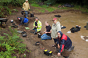 SAVEOCK WATER, CORNWALL, ENGLAND - AUGUST 03: A view from above of archaeologist Jacqui Wood, her team and students on August 3, 2008 in Saveock Water, Cornwall. They are excavating a Mesolithic platform. (Photo by Manuel Cohen)