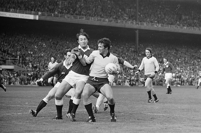 Galway player attempts to tackle Dublin player who has possession of the ball during the All Ireland Senior Gaelic Football Championship Final Dublin V Galway at Croke Park on the 22nd September 1974. Dublin 0-14 Galway 1-06.