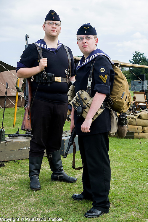 Two world war two re-enactors portraying German Naval Infantry or kriegsmarine Marine Infanterie Division in summer uniform. One is armed with the German Mauser K98 bolt action rifle the other is armed with an MP40 machine Pistol both are wearing ammunition pouches appropriate for the weapon on their belts. <br /> <br /> August 2015<br />  Image &copy; Paul David Drabble <br />  www.pauldaviddrabble.co.uk