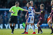Queens Park Rangers defender Angel Rangel (22) shouts at Referee Andrew Madley, shortly before being given a yellow card, during the EFL Sky Bet Championship match between Queens Park Rangers and Swansea City at the Loftus Road Stadium, London, England on 13 April 2019.