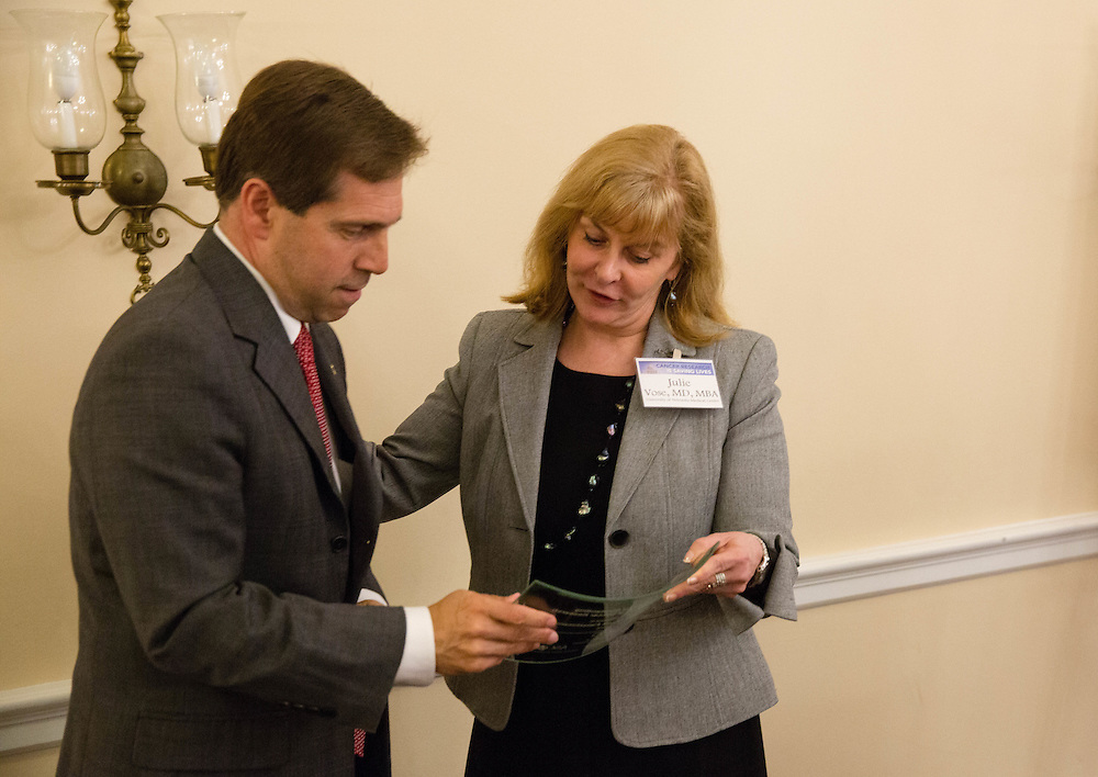 Presentation of award to Representative Chuck Fleischmann (R-TN) by Dr. Julie Vose, MD, MBA, FASCO, President of ASCO during the Hill Day reception held at Rayburn House Office Building in Washington, DC, on Wednesday, May 11, 2016. The American Association for Cancer Research (AACR), the Association of American Cancer Institutes (AACI), and the American Society of Clinical Oncology (ASCO) honored U.S. Representatives Kathy Castor (D-Fla.) and Chuck Fleischmann (R-Tenn.) for their outstanding leadership on behalf of cancer research during the reception. (Alan Lessig/)
