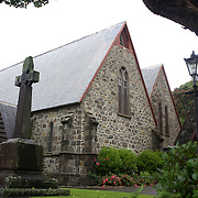 St Mary's Church Vivian Street, New Plymouth.The oldest stone church in New Zealand. Designed by Architect Frederick Thatcher, the original church was opened in 1846 and forms part of the present building. Benjamin Mountfort was responsible for the sanctuary, a five-sided apse. (1893). Marsland Hill behind the church was once a pa and then the headquarters of the British Army in north Taranaki during the 1860s. New Plymouth, Taranaki, New Zealand, 22nd December 2010. Photo Tim Clayton.