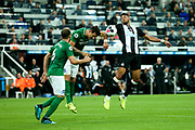 Lewis Dunk (#5) of Brighton & Hove Albion heads the ball clear as Joelinton (#9) of Newcastle United attempts to control it during the Premier League match between Newcastle United and Brighton and Hove Albion at St. James's Park, Newcastle, England on 21 September 2019.