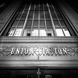 Union Station Chicago sign and entrance in black and white. Union Station opened in 1925 and serves as a train station for commuter trains.