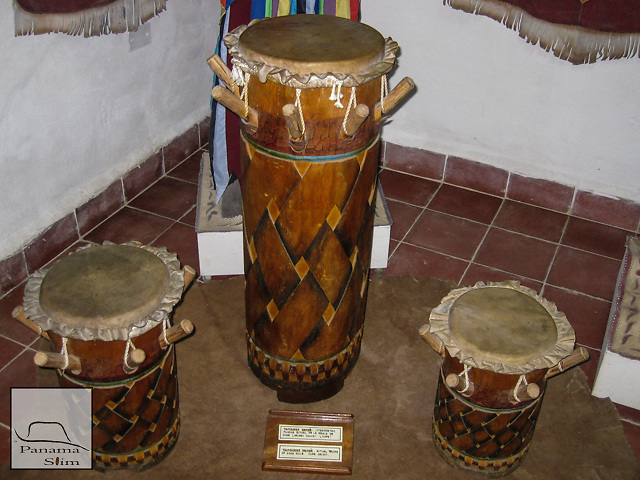 These drums are considered Nupe in origin, but are used in Lucumi ritual practices.  These are played is hands and sticks and are three in a set.  Although used in Lucumi ritual space, these drums are not sacred, as the Bata drums, and are not extensively prepared.  Bembe style, in modern practice, uses congas and shekeres.