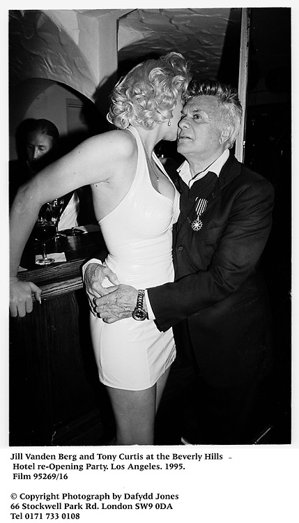 Jill Vanden Berg and Tony Curtis at the Beverly Hills Hotel re-Opening Party. Los Angeles. 1995. Film 95269/16<br /><br />© Copyright Photograph by Dafydd Jones<br />66 Stockwell Park Rd. London SW9 0DA<br />Tel 0171 733 0108