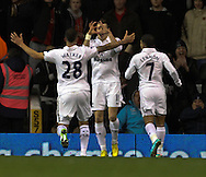Picture by David Horn/Focus Images Ltd +44 7545 970036.28/11/2012.Gareth Bale (centre) of Tottenham Hotspur celebrates with Kyle Walker and Aaron Lennon during the Barclays Premier League match at White Hart Lane, London.