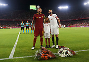 SEVILLE, SPAIN - AUGUST 10:  Daniele De Rossi of AS Rom (L), Aitor Puerta son of Antonio Puerta (C) and Nicolas Pareja of Sevilla FC (R) tribute died Player Antonio Puerta during a Pre Season Friendly match between Sevilla FC and AS Roma at Estadio Ramon Sanchez Pizjuan on August 10, 2017 in Seville, Spain. (Photo by Aitor Alcalde/Getty Images)