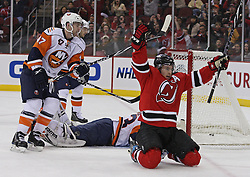 Apr 10, 2010; Newark, NJ, USA; New Jersey Devils left wing Zach Parise (9) celebrates his goal on New York Islanders goalie Martin Biron (43) during the first period at the Prudential Center.