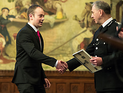 © Licensed to London News Pictures. 05/01/2018. Manchester, UK. PCSO LEWIS BROWN receives a Highly Commended award . Police officers and railway workers who came to the aid of victims in the wake of the terrorist attack at an Arina Grande concert at the Manchester Arena in May 2017 are honoured at a commendation ceremony at the Great Hall at Manchester Town Hall. Amongst those honoured are officers from British Transport Police and Northern Rail staff . Photo credit: Joel Goodman/LNP