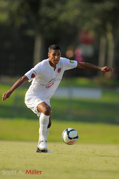 Orlando City midfielder Jonathan Mendoza (11) in action during the Orlando City U23s 2-1 win over the Laredo Heat in their PDL Southern Conference Championships playoff game at Trinity Catholic High Schooll on July 20, 2012 in Ocala, Florida. ..©2012 Scott A. Miller
