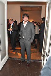 ALEX JAMES at the launch of the Krug Happiness Exhibition at The Royal Academy, 6 Burlington Gardens, London on 12th December 2011.