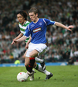 Steven Davis goes past Shunsuke Nakamura during the League Cup final between Rangers and Celtic at Hampden Park -<br /> David Young