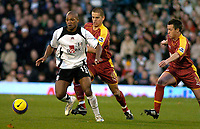Photo: Gareth Davies.<br />Fulham v Reading. The Barclays Premiership. 25/11/2006.<br />Fulham striker Collins John (L) run with the ball past the helpless Reading defenders.
