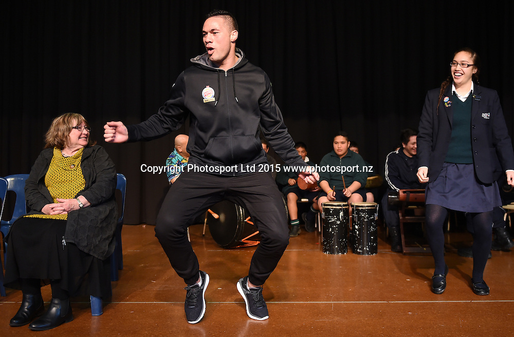 New Zealand Heavyweight boxer Joseph Parker breaks out into a traditional Samoan dance during a visit to Aurora College in Invercargill ahead of the Burger King Road to the Title fight. Thursday 30 July 2015. Copyright photo: Andrew Cornaga / www.photosport.nz