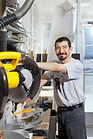 Portrait of a Hispanic employee using circular saw
