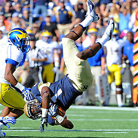 14 September 2013:   Navy Midshipmen cornerback Brendon Clements (1) is upended by Delaware Fightin Blue Hens running back Andrew Pierce (30) after an interception at Navy Marine Corps Memorial Stadium in Annapolis, MD. where the Navy Midshipmen defeated the Delaware Fightin Blue Hens, 51-7.