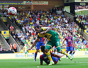 Bradley Johnson lucky not to get a penalty from this challenge during the Barclays Premier League match between Norwich City and Crystal Palace at Carrow Road, Norwich, England on 8 August 2015. Photo by Craig McAllister.