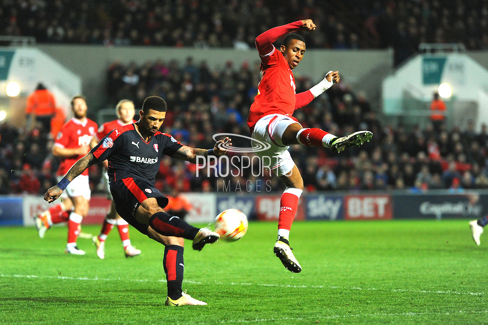 Rotherham United forward Leon Best is put under pressure from Bristol City forward Jonathan Kodjia during the Sky Bet Championship match between Bristol City and Rotherham United at Ashton Gate, Bristol, England on 5 April 2016. Photo by Graham Hunt.