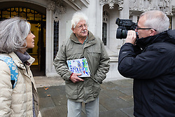 © Licensed to London News Pictures. 02/12/2014. London, UK. Peace campaigner, John Catt with his daughter Linda Catt arrives at the Supreme Court in London on 2nd December 2014. In 2013, judges at the Court of Appeal ruled in favour of Catt who fought to have his personal details about attendance at various protests and demonstrations against the arms trade removed from a police extremism database, but police are challenging that decision at the UK's highest court, the Supreme Court. Photo credit : Vickie Flores/LNP