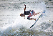 A surfer takes advantage of the ocean swell generated by a passing hurricane along the South Carolina coast in Folly Beach, SC