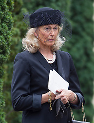 BRENTWOOD - UK - 11- SEPT - 2013: Britain's Prince Charles, The Prince of Wales,accompanied by Camilla, The Duchess of Cornwall and his sons Prince WIlliam and Prince Harry attend the funeral of Charles's close friend Hugh Van Cutsem at Brentwood Cathedral in Essex.<br /> Mrs Van Cutsem outside the Cathedral at the end of the service<br /> Photo by Ian Jones