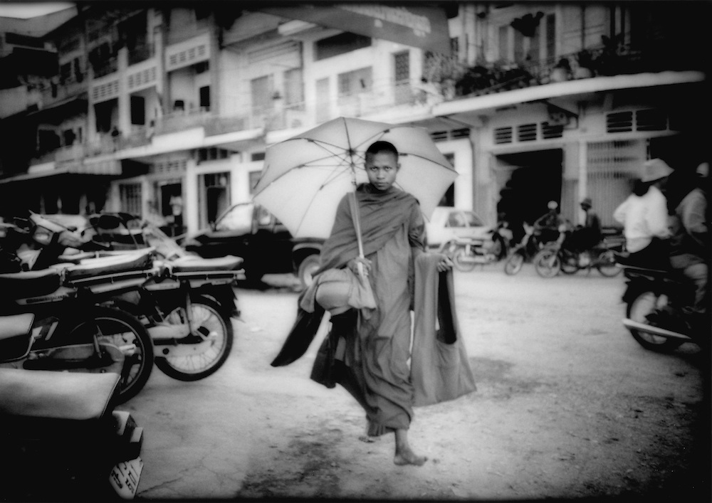 Bonze making morning rounds for alms, Phnom Penh, Cambodia.