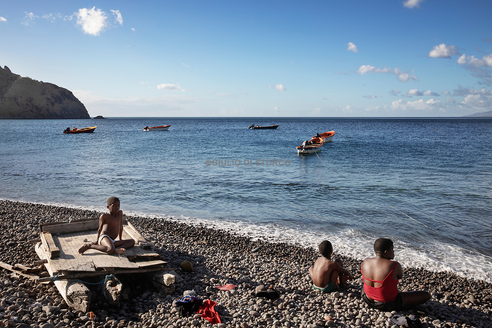 Children playing on the beach in the south of the island