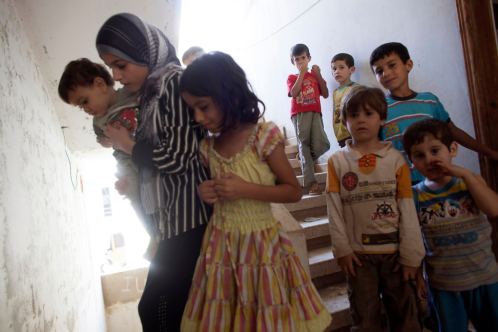 05/07/2013 near Damour, Lebanon: Syrian refugee children from Aleppo crowd the hallways of an apartment building that was rapidly renovated to accomodate the influx of refugees flooding the country. Estimates have placed the number of Syrian refugees in Lebanon at well over 500,000 people.
