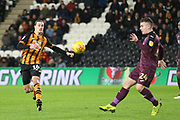 Hull City midfielder Jackson Irvine (16)and Swansea City defender Declan John (24) go for the same ball during the EFL Sky Bet Championship match between Hull City and Swansea City at the KCOM Stadium, Kingston upon Hull, England on 22 December 2018.