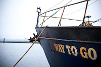 """Scenes from Newport, Oregon including fishing boats and the Yaquina bridge and crabbing baskets.  A boat called """"way to go"""""""