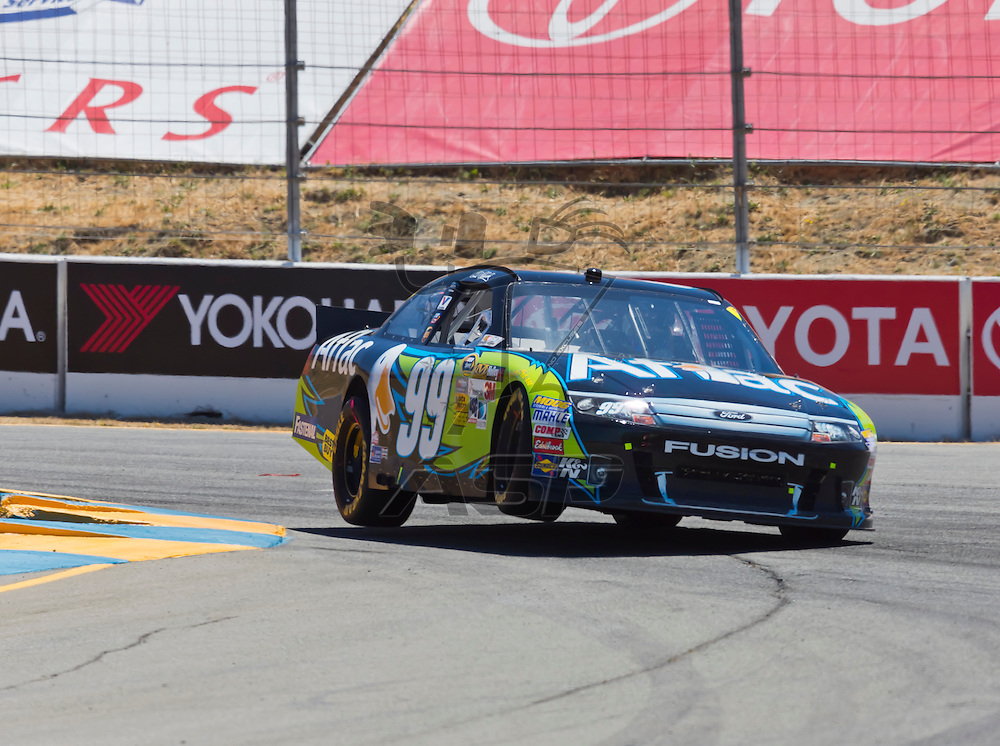 SONOMA, CA - JUN 24, 2012:  Carl Edwards (99) brings his car through the turns during the Toyota Save Mart 350 at the Raceway at Sonoma in Sonoma, CA.