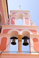 The pink and white belltower of Agios Triada in Gaios, Paxos, Ionian Islands, Greece