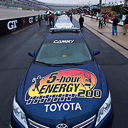 The 5-hour Energy Pace car sits in front of Nationwide Series cars crew during a rain delay at the Nationwide Series race at Dover International Speedway in Dover Delaware..