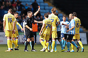Millwall FC midfielder Shaun Williams (6) is sent off and receives a red card  during the Sky Bet League 1 match between Coventry City and Millwall at the Ricoh Arena, Coventry, England on 16 April 2016. Photo by Simon Davies.