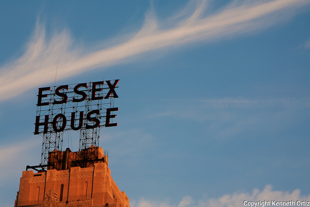 The top of the Essex House hotel in New York City during a sunset.