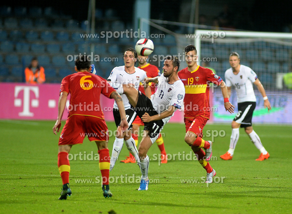 09.10.2015, Gradski Stadion, Podgorica, MNE, UEFA Euro Qualifikation, Montenegro vs Oesterreich, Gruppe G, im Bild Zarko Tomasevic, Julian Baumgartlinger, Martin Harnik, Stefan Mugosa // during the UEFA EURO 2016 qualifier group G match between Montenegro and Austria at the Gradski Stadion in Podgorica, Montenegro on 2015/10/09. EXPA Pictures © 2015, PhotoCredit: EXPA/ Risto Bozovic