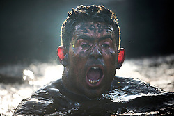"""©  London News Pictures. 27/01/2013.  A Competitor surfacing from freezing cold muddy water during the 2013 Tough Guy Challenge on January 27, 2013 in Wolverhampton, England. The event has been widely described as """"the toughest race in the world"""", with over one-third of the starters failing to finish in a typical year. Photo credit: Ben Cawthra"""