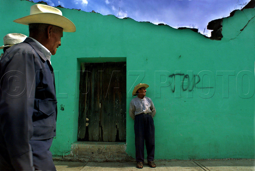 Jairo Lopez Fernandez, at center, lives in the small town of San Nicolas de los Ranchos. His home is in the direct path of mudflows that will be caused by melting glaciers on El Popocatépetl peak during an eruption.