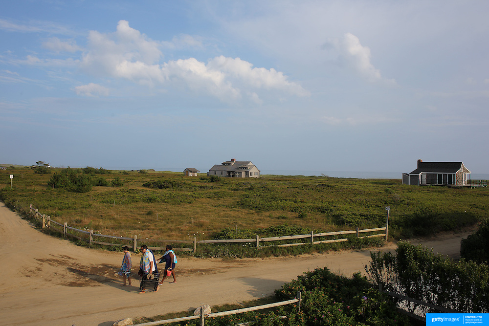 Beach goers head back along a track from Cisco Beach, Nantucket, Nantucket Island, Massachusetts, USA. Photo Tim Clayton